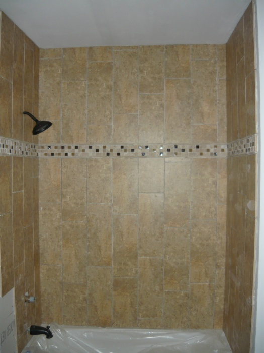 Just a few more pieces of tile to go in then grout.  Not bad for my first wall tile job ever.