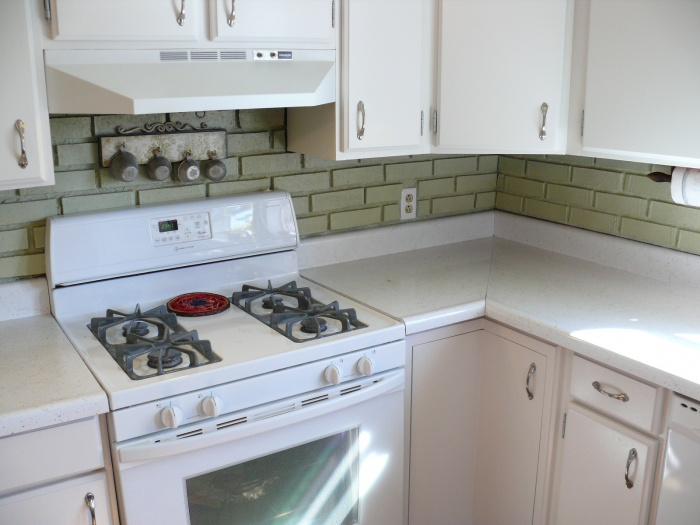 """Just finishing re-painting cabinets with an off-white Sherwin Williams. Counter """"before"""" shot, will need sanded."""