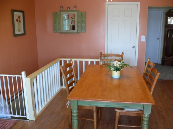 lots of fresh paint! banister is just 2x4s and 2x2s pretty primitive but looks fine with paint.