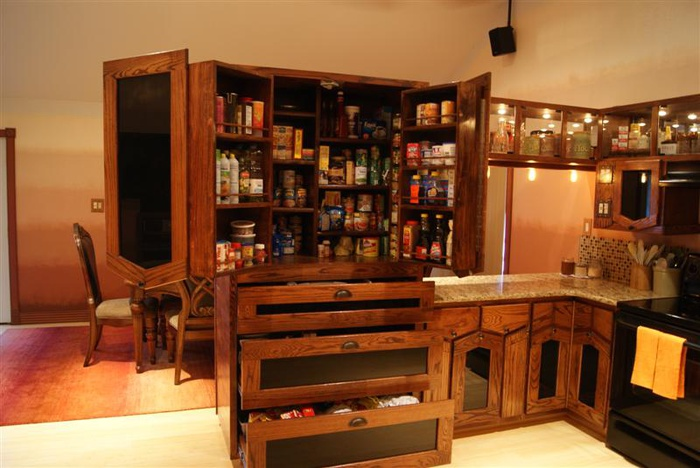 Pantry opened up - note the peculiar piano hinge design.  each door uses 3 hinges to allow a full access opening