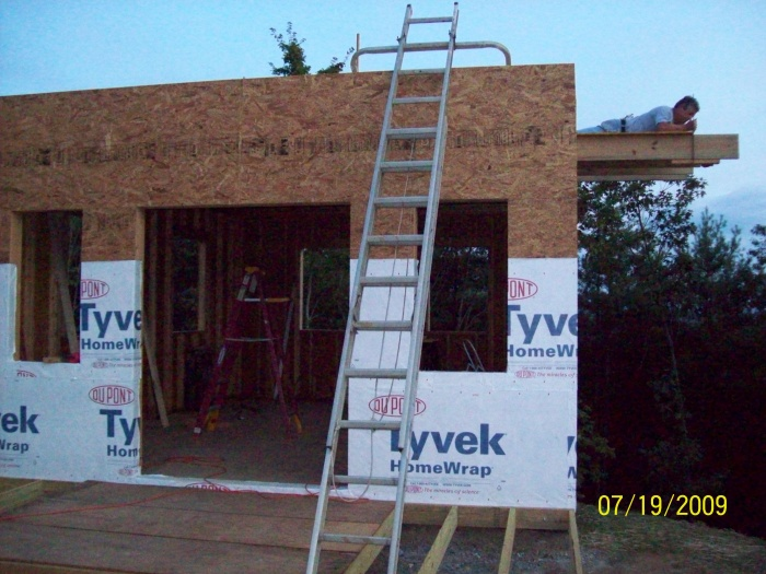Putting in the catilevered 2nd floor landing and starting on the house wrap.