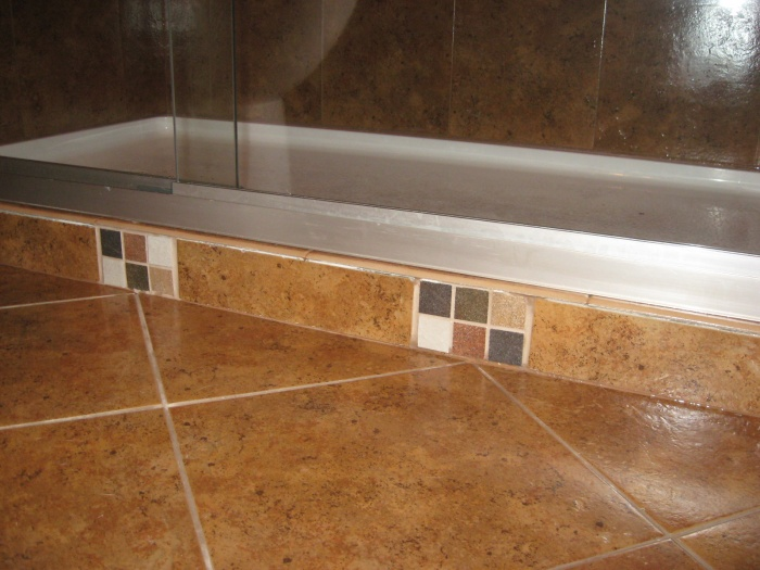 Shower curb for shower doors for more elbow room!