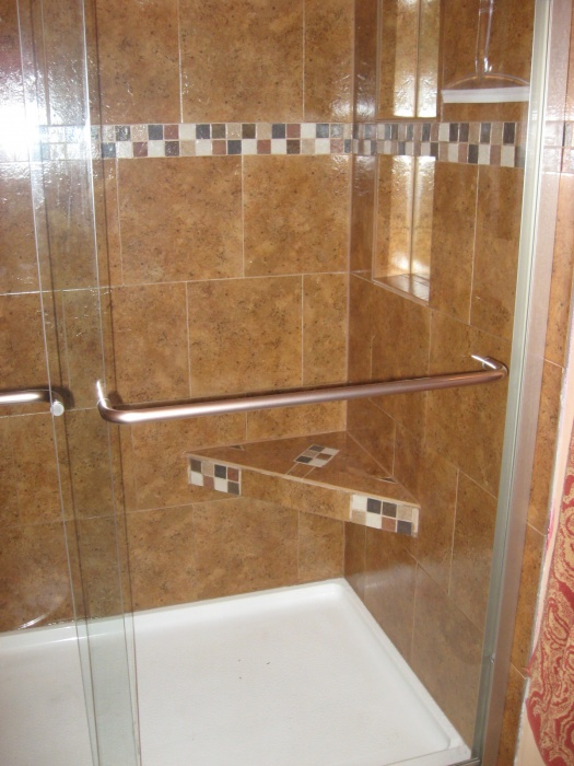 Shower with mirrored niches and shower bench