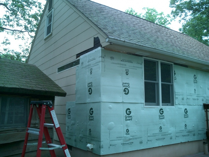 Start of wrapping the house insulation board.  Using this board we were able to get a nice even starting base.