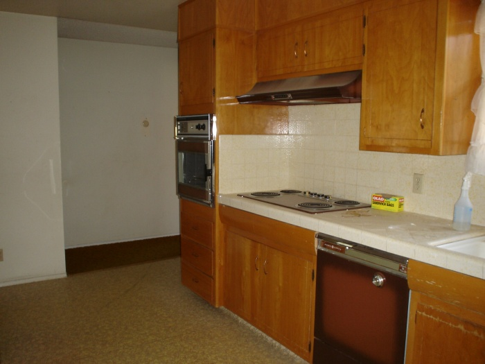 summer 2008 026 Before 1960's kitchen, that is yellow dal-tile and original vinyl flooring