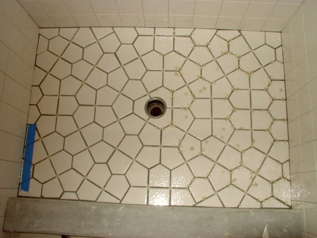 tessellation tile shower floor layout- 2 different pentagons is all- A tessellation or tiling of the plane is a collection of plane figures that fills the plane with no overlaps and no gaps. Tessellations frequently appeared in the art of M. C. Escher. Tessellations are seen throughout art history, from ancient architecture to modern art.   source wikipedia