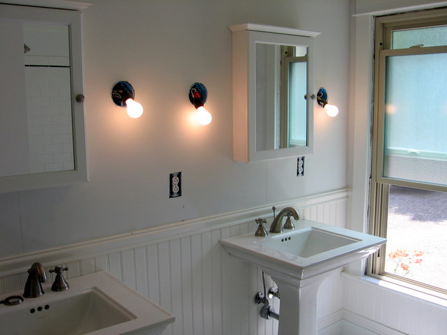There were twin pedestal sinks installed, wainscoting with chair rail and twin mirror/medicine chests.