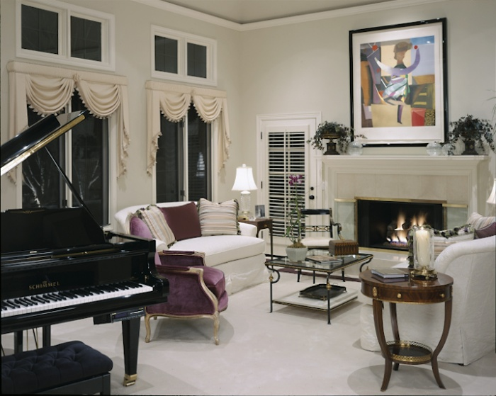 This living room was for my clients who loved to entertain formally.   favorite pieces in this room are the plum silk velvet Louis chairs. Only one is visible.   All the furniture was from the Beacon Hill showroom.