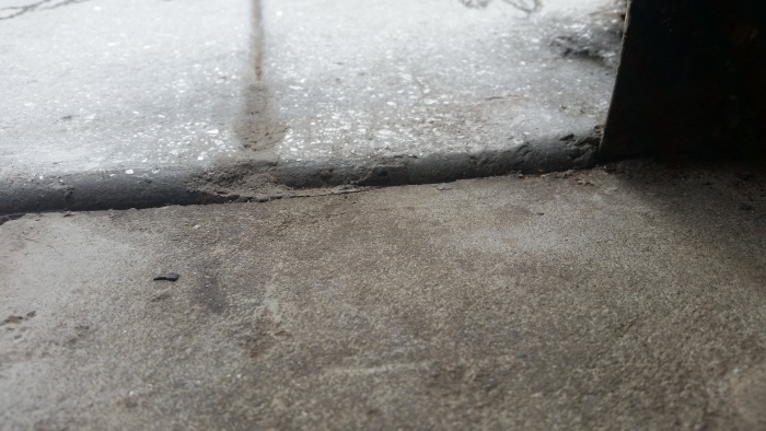 The Photo Below Shows Sidewalk Outside On Top And Garage Floor Inside House Bottom