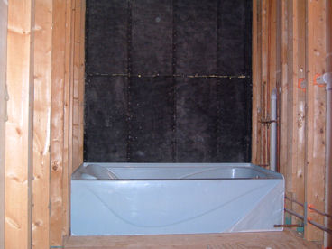 Wall insulated with cellulose.