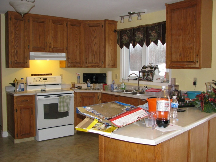 What color to paint cupboards, walls are butter Yellow right now, but open to change.  wood is tired and dry.